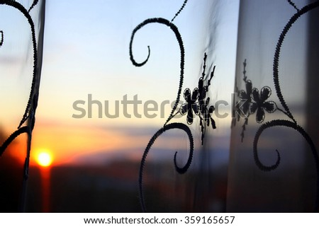 Abstract background with tulle over sunset and sky, shallow dof - stock photo