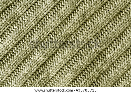 Abstract beige knitted cloth texture. Background and texture for design. - stock photo