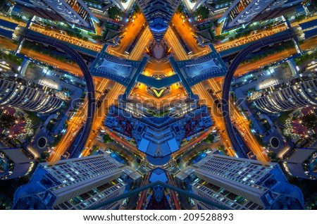 Abstract Birds eye view of a modern building at night. Traffic in the business district The Skytrain station Chong Nonsi - stock photo