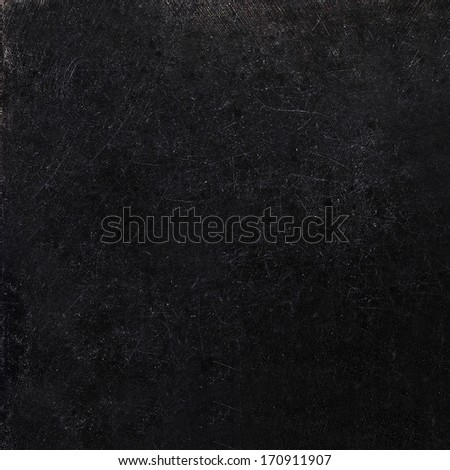 Abstract black background with scratches. Vintage grunge background texture, elegant monochrome background design. Grungy textured blackboard. - stock photo