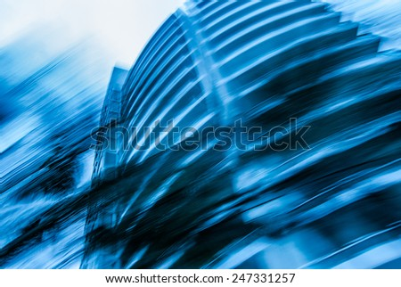 Abstract blue Background with skyscraper office building in worm's-eye view  Blur background for book cover, brochure, poster, magazine, CD cover design, website, app mobile, annual report - stock photo