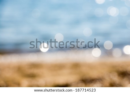 Abstract blue blur of seashore with bokeh - stock photo