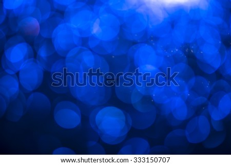 Abstract blue bokeh christmas holidays lights on background. - stock photo