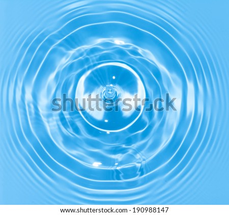 Abstract blue circle water drop ripple. Liquid texture background. - stock photo