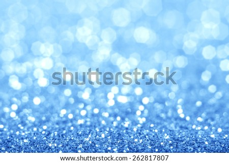 Abstract blue glitter background. Shiny glitter bokeh christmas background. - stock photo
