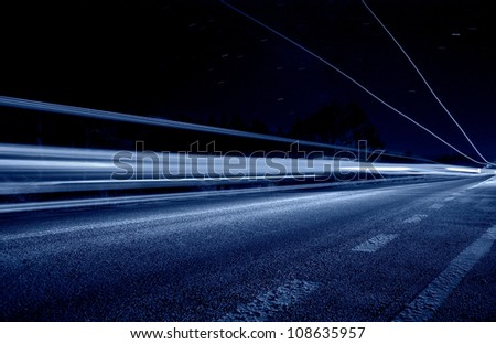 Abstract blue lights with centerline in a road tunnel - stock photo
