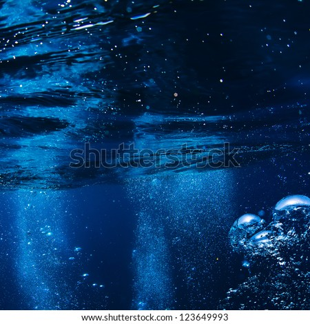 abstract blue underwater surface and ripples - stock photo