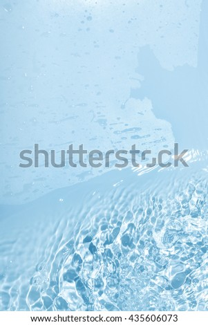 Abstract blue water background with many drops and drips - stock photo