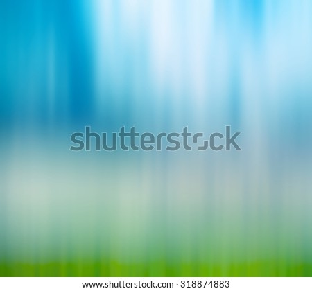Abstract blur background of blue sky and grass - stock photo