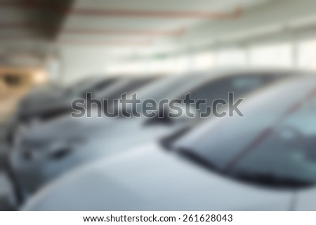 Abstract blur background of car parking, shallow depth of focus - stock photo
