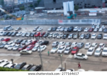 Abstract blur background of car parking, shallow depth of focus, top view - stock photo