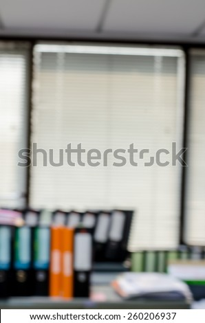abstract blur background of row of binders in an office archive - stock photo