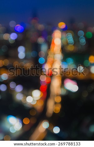 Abstract blur bokeh of city road at night - stock photo