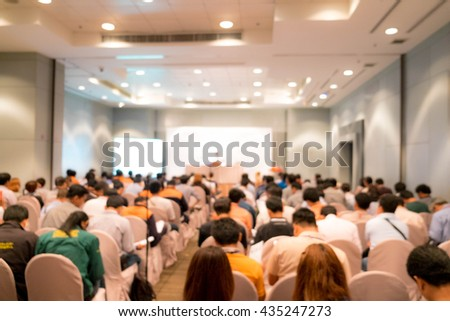 Abstract blur conference seminar room - stock photo