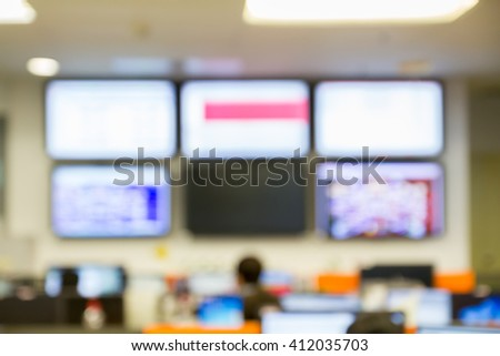abstract blur focus LED TV use monitor network in Network Operating Center room - stock photo