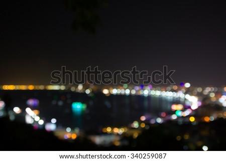 abstract blur focus Pattaya bay at night - stock photo