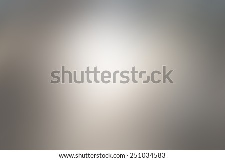 Abstract blur gray background with white light in the middle - stock photo