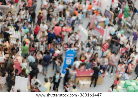 Abstract blur many urban people in the mall for background - stock photo