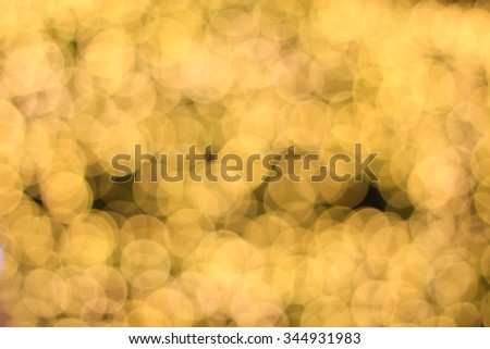 abstract blur of gold glitter bulbs lights of Christmas festival:blur circle lights in golden warm toned backgrounds wallpaper concept:xmas decorate backdrop.  - stock photo