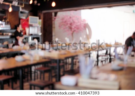 Abstract blur people in restaurant or food center with light bokeh background. - stock photo