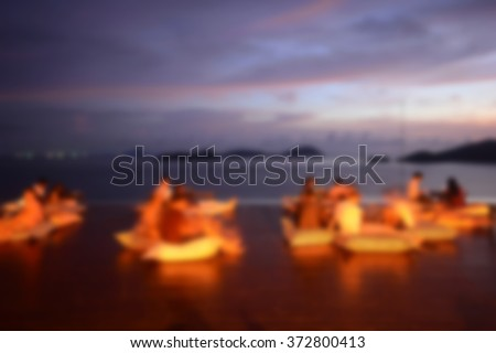 Abstract blur people watching sunset, beach party - stock photo