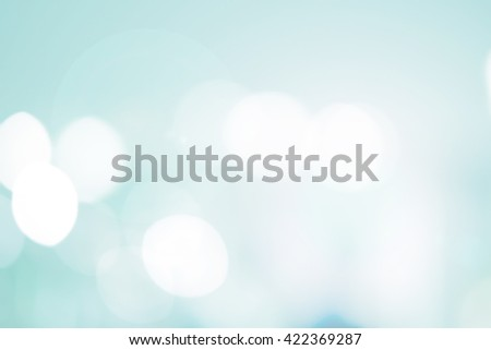 abstract blur soft blue teal color background concept:blurry shine glittering ball shine backdrop:blurred gradient sparkling bokeh light wallpaper conceptual:christmas festive and happy new year card. - stock photo