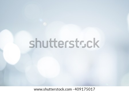 abstract blur white gray color background concept:blurry soft glittering ball shine backdrop:blurred gradient sparkling bokeh light wallpaper conceptual:christmas festive and happy new year card. - stock photo