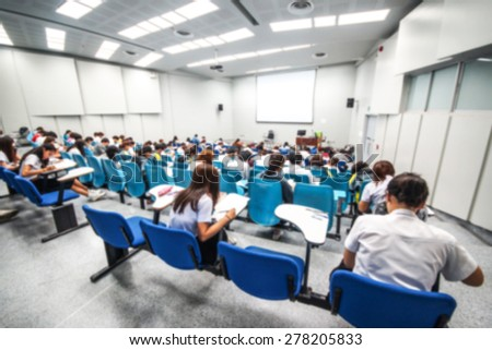 Abstract blurred background of university students in a large lecture room - stock photo