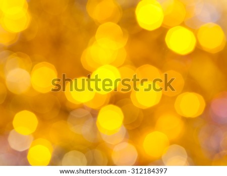abstract blurred background - yellow shimmering Christmas lights bokeh of electric garlands on Xmas tree - stock photo