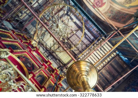 Abstract blurred backgrounds - inside an orthodox cathedral under reconstruction. Wooden ceiling and golden chandelier - stock photo