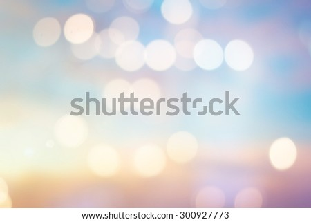 abstract blurred backgrounds of twilight backdrop with circle lights in pastel tone.blur of bokeh circle light christmas festive backdrop concept. - stock photo