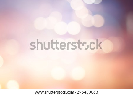 abstract blurred beauty background with circle lights in pastel warm tone color.blur of bokeh sparkle of Christmas backdrop concept.blurry glitter xmas decoration banner template:sunshine of summer. - stock photo