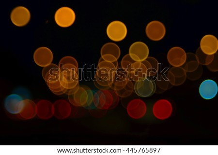 Abstract blurred bokeh background colorful image of light from cars at night time - stock photo