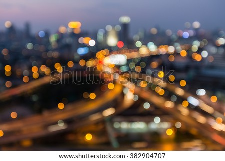 Abstract blurred bokeh city downtown road interchange night view - stock photo