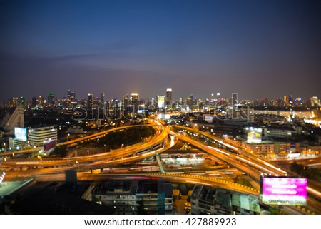 Abstract blurred bokeh lights highway interchanged and city downtown background, night view - stock photo