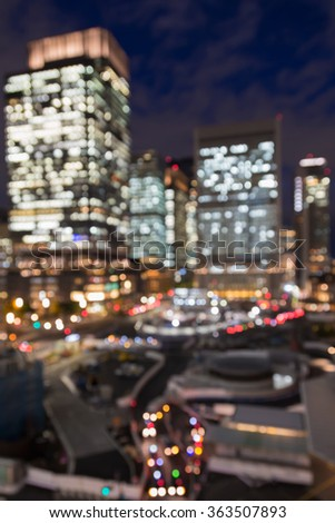 Abstract blurred bokeh lights, Tokyo city office building at night - stock photo