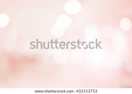abstract blurred elegant soft brightening pink background:blur old rose colorful backdrop with bokeh lucent light:beauty shiny wallpaper with lens flare light effect filter:vivid vintage tone image. - stock photo