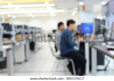 abstract blurred employee thoughtful about programming system:blur people working/researching data information concept:blur group of computer/network engineering focus assignment at computer laptop. - stock photo