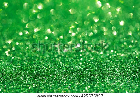 Abstract blurred green festive sparkling background. Selective focus. - stock photo