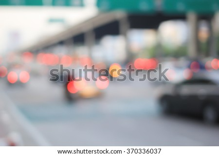 abstract blurred group of vehicles on road street background:blur of cars driving in the city construction concept.movement of vehicles in traffic jam hours:blur working day concept.congest transport. - stock photo