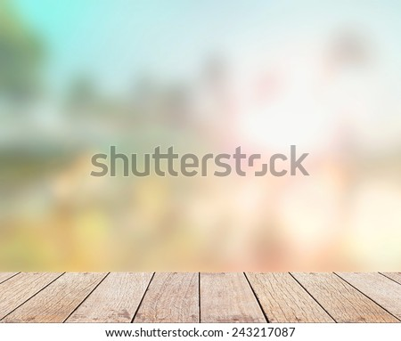 Abstract blurred nature textured background with wooden paving: yellow and blue patterns. The beautiful beach backdrop over colorful sunset or sunrise. Summer holidays, Environment, Ecology concept. - stock photo