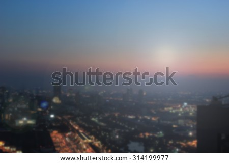 Abstract Blurred night city background with circle light.blur downtown construction structure backgrounds concept.blurry urban place sunset/sunrise hours wallpaper with sparkle lights. - stock photo