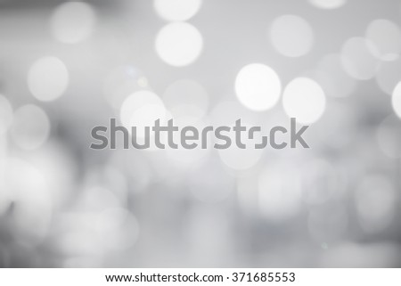 abstract blurred of bokeh light in black and white background:blurry circle shiny light in gray scale tone color.image display for design,decorate:blur of motion lights backdrop with brightening flare - stock photo