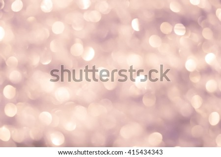 abstract blurred of glamour vintage and bronze glittering shine bulb lights background:blur of Christmas day wallpaper decoration concept.xmas festival backdrop:sparkle circle celebration display - stock photo