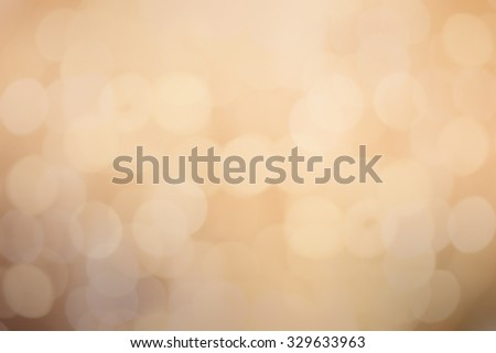 abstract blurred of golden colour backgrounds with circle lights.blur of bokeh circle light christmas festive backdrop concept:blur gold yellow backdrop concept - stock photo