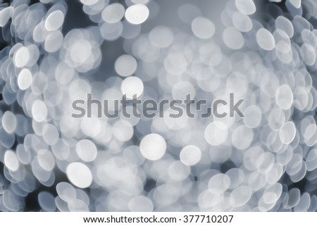 abstract blurred of grey/silver/bronze glittering shine bulb lights background:blur of Christmas day wallpaper decoration concept.xmas design festival backdrop:sparkle circle celebration display. - stock photo