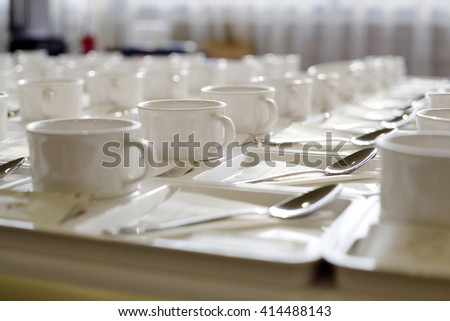 Abstract blurred of many rows of coffee or tea cups for background - stock photo