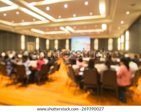 Abstract blurred  people in  meeting or conference room for background. Warm tone photo. - stock photo