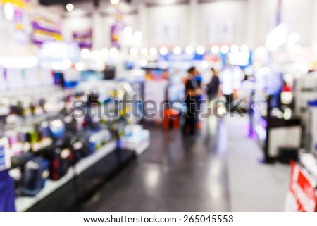 Abstract blurred people shopping in department store - stock photo