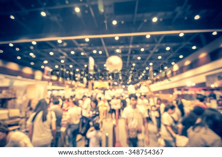 abstract blurred people shopping - products on sale - stock photo